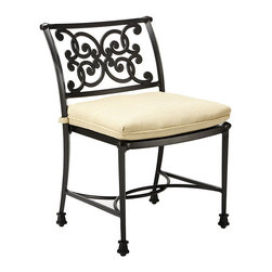Ballard Designs - Amalfi Dining Side Chairs - Set of 2 - Coordinates with our Amalfi Outdoor Collection. Basic tan cushions included. Sand black finish resists rust and chipping. Extremely strong, yet light enough for easy placement. Replacement cushions available. Requires 1 replacement cushion set per chair. Since each piece in the inviting Amalfi Collection is crafted of cast aluminum, the decoration can be more ornate and finely detailed. Dining Side Chair seat features an intricate basket weave design with a rich 3-dimensional look. Back is beautifully scrolled on both sides, so you can enjoy the pattern from behind. And because cast aluminum is extremely strong and much lighter than it looks, this Side Chair places easily and yet feels reassuringly sturdy. Amalfi Dining Side Chair features: . . . . . Use of an outdoor furniture cover is recommended to extend the life of your piece.