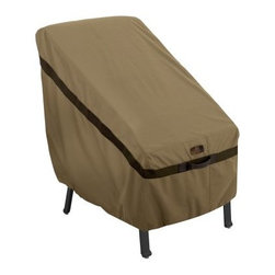 Classic Accessories Hickory Highback Chair Cover - Tan - The Classic Accessories Hickory Highback Chair Cover - Tan is a stylish way to protect your highback patio chair this winter. It's made of Weather10 material in handsome tan with Weather Leather trim that looks authentic yet won't rot. Padded handles make it easy to put on and take off. Large air vents prevent wind lofting and mildew. For a secure fit, this cover uses a combination of click-close straps and an adjustable elastic hem cord. It comes with a waterproof, laminated liner and is designed to fit most patio chairs. It includes a manufacturer's limited lifetime warranty.About Classic AccessoriesFounded from small beginnings, Classic Accessories has grown in the past 30 years from a small basement operation in Seattle's Roosevelt neighborhood making seatbelt pads and steering wheel covers, to a successful and expanding company now making a wide variety of products from car to boat covers and much more. Innovative, stylish designs define products that are functional and made to last. From little details to the largest innovations, Classic Accessories is always moving forward and looking to provide cover and storage solutions to a clientele that has a passion for the outdoors, from backyard gatherings to exciting camping trips, Classic Accessories provides the products that keeps your equipment looking great all season long.