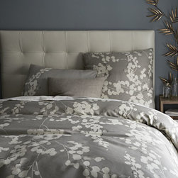 Moonflower Duvet Cover - For a bit of a subdued touch, consider this delicate white floral pattern for the master room.  Feminine enough for her but the dark colors suit him too.