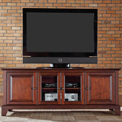 Crosley - Crosley Newport 60 in. Low Profile TV Stand - Vintage Mahogany Brown - KF10005CM - Shop for Visual Centers and Stands from Hayneedle.com! The Crosley Newport 60 in. Low Profile TV Stand - Vintage Mahogany offers versatile media storage in traditional style. This low slung entertainment cabinet is sized to accommodate modern homes and holds most 60-inch flat panel TVs. It is made of hardwood and high quality veneers with a hand rubbed multi-step vintage mahogany finish and antique brass hardware. Three adjustable shelves offer plenty of storage options and cord management holes tame all those wires. Two raised panel doors conceal stacks of DVDs games and media players while tempered glass doors protect electronic components from dust and allow remote control access. Classic good looks and storage too!Additional Features:Accommodates up to a 60-inch flat panel TV3 adjustable shelves give 6 levels of protected storageDual tempered glass doors allow remote control access2 side cupboards with raised panel doors and 1 adjustable shelf eachCord management featureAbout Crosley FurnitureIn 1920 Powel Crosley founded the company that pioneered radio broadcasting and mass market manufacturing around the world starting with a simple radio meticulously crafted with obsessive detail and accuracy and a measure of consideration for the wallet. These high ideals have served the company well for over 90 years and they live on in the newest addition to the family. Crosley Furniture sets a new standard for innovation function and meticulous craftsmanship in the manufacture of value-priced furniture. They proudly offer durable furniture products featuring hardwood and veneer construction with rich multi-step finishes in a multitude of styles.