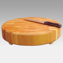 Round End Grain Butcher Block - The Round End Grain Butcher Block is made from oil-finished natural yellow birch hardwood which is indigenous to the Northeastern U.S. and ranges in color from blond to a darker walnut shade; the natural variation in color allows this cart to coordinate with your existing decor. End grain construction is designed to cushion the knife blade every time you cut reducing wear on your knives as well as preventing the board from getting nicked or scratched. It also creates a beautiful cross-hatched pattern in the natural wood surface. This butcher block is round and has four wooden ball feet with rubber pads on the underside providing a solid work surface that won't slide across the countertop or leave scratches. This block is available in two sizes.Catskill Craftsmen's Eco-friendly PracticesCatskill Craftsmen is committed to protecting the environment through responsible forest management and manufacturing practices. Located in the Catskill Mountains of upper state New York Catskill Craftsmen plays a role in maintaining the health of the New York City watershed. This watershed provides clean water for New York City and other communities in the area. Healthy well-managed forests are better able to filter pollutants from entering streams and rivers which preserves the quality of watershed resources. With this goal in mind the company supports the efforts of the Watershed Agricultural Council (WAC). With the WAC Catskill Craftsmen encourages lumber suppliers (family forest owners and public land managers) to make wise harvesting decisions and control erosion in order to safeguard water quality.Other efforts to protect the environment include using sustainable wood sources and reducing wood waste. Catskill Craftsmen's manufactured items are made from naturally self-sustaining non-endangered North American hardwoods primarily birch and hard rock maple. All sawdust shavings and waste materials generated during the manufacturing process are converted into wood pellet fuel used to heat homes. This alternative heating source creates less ash and lower emissions than some other fuels. By operating their own wood pellet mill Catskill Craftsmen reduces their wood waste to zero. As natural resources become even more valuable Catskill Craftsmen will continue to advance proper stewardship of the pristine Catskill Mountain region.About Catskill CraftsmenFor over 60 years Catskill Craftsmen has provided customers with high-quality domestic hardwood ready-to-assemble products. Located in Stamford New York Catskill Craftsmen manufactures kitchen carts islands work centers gourmet butcher block chopping blocks cutting boards hardwood cabinets furniture book carts and racks. Catskill Craftsmen is recognized as the nation's leading manufacturer of premium wooden products.