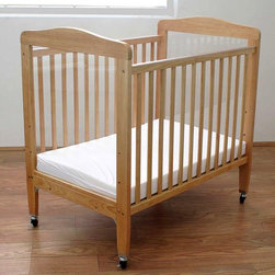 LA Baby - LA Baby Compact Wood Non Folding Crib with 3 in. Mattress - Natural - WC510N - Shop for Cribs from Hayneedle.com! LA Baby knows what institutional child-care equipment usually looks like and that's why they are offering you the classic homey style of the LA Baby Compact Wood Non Folding Crib with 3 in. Mattress - Natural. Made from solid wood in a natural finish this strong crib lets you choose from three adjustable mattress heights for their safety and your convenience. The scratch-resistant finish makes for easy cleaning and you'll be able to keep a watchful eye on the little nappers through the large shatter-proof acrylic windows on each end of this cozy crib. The included 3-inch mattress meets all Federal standards regarding flammability and the locking heavy-duty casters will let you move it when you need to and stop it when you get there.About LA BabyL.A. Baby is an award-winning division of Amwan a manufacturer and distributor of fine quality juvenile furniture. With products designed for residential and commercial use L.A. Baby items can be found in homes day cares and hotels. Based in City of Industry California L.A. Baby offers a wide range of baby items including cribs strollers safety gates changing pads and high chairs.