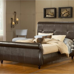 Fremont Leather Sleigh Bed - The lap of luxury goes from a phrase to a reality when you're bedding down in the Fremont Leather Sleigh Bed. Crafted with a solid sturdy wood frame this bed gets drama from an extra-tall headboard and low footboard both elegantly curled and curved and covered in sumptuous chocolate-brown leather. The full upholstery is subtly paneled and tufted for a sleek traditional feel. Carved feet and upholstered side rails complete the look. Available in two sizes. Complete Bed Dimensions Queen: 83.5L x 64W x 64H inches King: 83.5L x 81W x 64H inches About Hillsdale FurnitureLocated in Louisville Ky. Hillsdale Furniture is a leader in top-quality affordable bedroom furniture. Since 1994 Hillsdale has combined the talents of nationally recognized designers and globally accredited factories to bring you furniture styling and design from around the globe. Hillsdale combines the best in finishes materials and designs to bring both beauty and value with every piece. The combination of top-quality metal wood stone and leather has given Hillsdale the reputation for leading-edge styling and concepts.