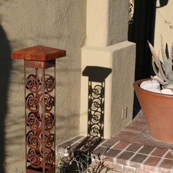 Attraction Lights overview - Swirls 6x6 Bollard, natural rust finish.  Shadow patterns night and day!  Photo by Lyle Braund