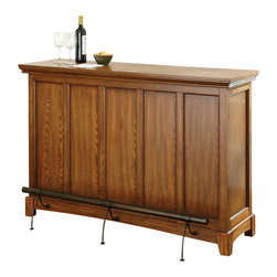 Steve Silver Furniture - Steve Silver Martinez Bar w/Foot Rail in Medium Oak - 42 Inch - Bar w/Foot Rail in Medium Oak belongs to Martinez Collection by Steve Silver Enjoy the company of family and friends around the Martinez bar. The bar is constructed of hardwood solids and veneers in a medium oak finish and features storage for stemware and bottles along with a spacious shelf. The stylish front footrest is included with the bar. The Martinez offers a gorgeous bar that will be the focal point of your space.  Bar (1)