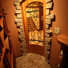 Traditional Wine Cellar by Architectural Justice