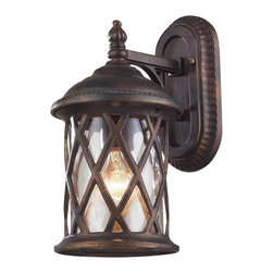 """Elk - Barrington Gate 13"""" High Outdoor Wall Light - Dress up garage areas porches and more with this handsome outdoor wall light design from Elk Lighting. Part of the Barrington Gate collection the design features hammered clear glass panels for an antique look. A hazelnut bronze finish adds to the rich visual appeal. Takes one 60 watt bulb (not included). 13"""" high. 7"""" wide. Extends 9"""" from the wall.  Hazelnut bronze finish.  Hammered clear glass.  Takes one 60 watt bulb (not included).   13"""" high.   7"""" wide.   9"""" from the wall."""