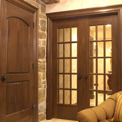Custom Poplar Interior Doors - Custom poplar interior two panel continental and 15 lite french double door with custom casing and Emtek oil rubbed bronze rope knob door hardware.