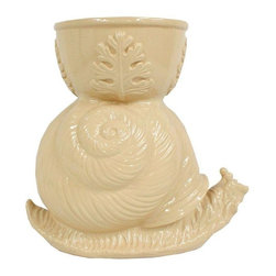 Pre-owned Regency Large Garden Snail Planter Statue - 1970s large ceramic beige snail sculpture with planter attached. This is a great quality heavy duty piece that would look great indoors or out. It is in good condition overall, but it shows some age appropriate wear. This planter would be a great addition to any Mid-Century Modern, regency or eclectic décor.
