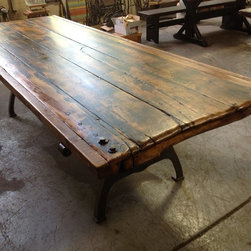 Salvaged Door Tables - One of a Kind Conference tables made from 2 1880's era mill doors on iron legs made from molds of 19th Century Jewelery machine legs.