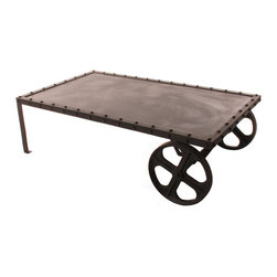 Kathy Kuo Home - Vintage Industrial Iron Transfer Cart Coffee Table - The spare, industrial rubbed iron of this vintage cart delivers a coffee table that fits perfectly in any urban space. Hip enough to rest your martini on, sturdy enough to rest your leather boots on-what more do you need at the end of the day?