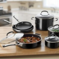 Calphalon - Calphalon Simply Enamel Nonstick 10-Piece Cookware Set Multicolor - 1756542 - Shop for Cookware Sets from Hayneedle.com! If you have the proper basic equipment there's no kitchen task you can't handle and all that equipment is available in the Calphalon Simply Enamel Nonstick 10-Piece Cookware Set. Each container has a body of rugged anodized aluminum that's finished with a high-quality non-stick surface that will make cooking easy and clean-up easier. The handles of the pots pans and lids all have a cool-to-the-touch silicone exterior that won't leave you looking for a hot mitt and if your meals need a little more cooking time you'll be glad that every piece in this set is oven-safe up to 400 degrees. The clear lids and the stove-top pieces are all dishwasher safe.About CalphalonCalphalon's mission is to be the culinary authority in kitchenwares enhancing the home chef's food experience during planning prep cooking baking and serving. Based in Toledo Ohio Calphalon is a leading manufacturer of professional quality cookware cutlery bakeware and kitchen accessories for the home chef. Calphalon is a Newell-Rubbermaid company.Calphalon's goal is to give you the home chef all the tools you need to realize your highest potential in the kitchen. From your holiday roasting pan to your everyday fry pan count on Calphalon to be your culinary partner - day in and day out for breakfast lunch and dinner for a lifetime.