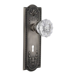 Nostalgic Warehouse - Nostalgic Meadows Plate with Crystal Knob and Keyhole in Antique Pewter (704312) - The antique pewter Meadows Plate, with its intricate beaded detailing and botanical flourishes, creates an inspired design theme. Add our Crystal Knob, with its smooth center flawlessly flowing into fluted edges, for a striking match. All Nostalgic Warehouse knobs are mounted on a solid (not plated) forged brass base for durability and beauty.