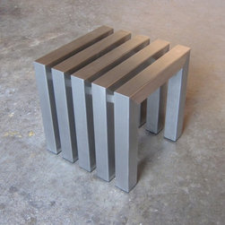 Linear Stainless Steel Cube | Sarabi Studio - This modern stainless steel cube is great for use year round indoors and out. Hand crafted from over 20 feet of 14 gauge 304 stainless steel tubing that is precisely cut welded and hand grained to a #3 finish, the linear bench is a substantial piece of furniture designed to last a lifetime. We offer custom sizes of this line with short lead times, if you would like to get a same day price quote please email or call us at 512.425.0675 any time, we would love to hear from you!