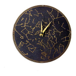 Constellation Clock - This handmade constellation wall clock is a daydreamer's delight. Featuring a  black background with stunning gold printed stars, this designer wall clock captures the spirit of travel magnificently. Handcrafted from upcycled materials, it makes an exceptional gift for a friend or coworker.  Make your moments count and give this gift of time to someone you love. This is a limited edition original design.