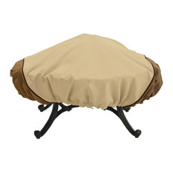 "Classic Accessories - Veranda Round Fire Pit Cover - Veranda Round Fire Pit Cover with the Gardelle Fabric System features an elegant fabric top with a protective water-repellent and resistant PVC undercoating and a protective dark splash guard skirt. Air vents reduce inside condensation and wind lofting. Padded handles for easy fitting and removal. Elastic hem cord with a toggle allows adjustment for a tight and custom fit. Click-close straps snap over legs to secure cover on the windiest days. Fits round fire pits up to 44"" diameter. Not designed to entirely cover leg bottoms."