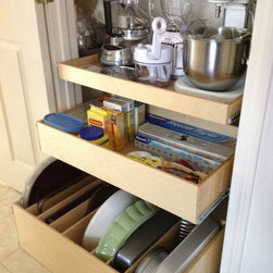 Pull Out Shelves and Tray Bin - Pull out shelves from ShelfGenie of New Hampshire organize everything from appliances to cooking utensils to food items.  This closet features a single-height pull out shelf to store appliances out of sight, yet easily accessible when needed.  Each shelf holds up to 100 pounds, allowing you to store whatever is necessary!  The second shelf is double-height, providing stability for the items stored within.  And the bottom tier is a tray bin for storing flat items like cookie sheets, cutting boards and platters upright and easy to grab!