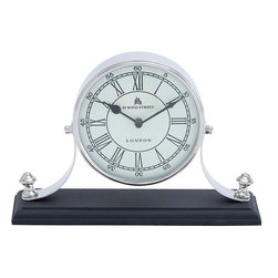 Benzara - Traditional Table Clock with Classic Design - Neat and elegant in appearance, this beautiful Metal nickel plated table clock offers functional use and attractive style, perfect for any setting. This clock features a simple classic design, which can complement traditional settings best. The elegant clock has a round face that is affixed to a firm base, which in turn ensures it is well balanced. The face of the clock features a pristine white color that is complemented with bronze colored Roman numerals. It is perfect for setting on tables or mantles, and can complement all kinds of settings perfectly. It is made from quality metal, which ensures durability. The clock has a sturdy body that is made from quality metal to ensure long lasting performance. This elegant table clock is a perfect gifting option too..