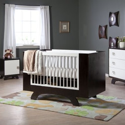 Dutailier 2 in 1 Convertible Crib Collection - Definitely designed with both the safety and style needs of modern parents in mind, the Dutailier Convertible Crib Collection sets the bar for Baby's future tastes. This uber-stylish crib is available on its own or with the optional matching 3-drawer dresser and/or night table. Each piece is crafted of 100% eco-friendly wood and has been finished to perfection in contrasting shades of espresso and white. The crib comes with a single-bed conversion kit so it can change with your baby's growing needs. The dresser and night table have hinged doors with stoppers and self-closing hardware for safety, and the dresser's drawers are divided to keep small separates in place and organized. Keep the look consistent and totally chic with the whole set!Optional Furniture Dimensions:3-Drawer dresser: 46W x 19.75D x 35H in.Night table: 18W x 16D x 22H in.About DutailierDutailier is a privately owned Canadian company established nearly 30 years ago. The company began as a manufacturer of wood components and furniture, including a limited number of glider rocker models. In 1988, Dutailier began focusing all research and resources into becoming the premier producer of glider rockers. It succeeded by bringing the finest technology, superior quality and durability, and patented mechanisms to its furniture. With this expertise, Dutailier has manufactured more than 4 million chairs in North America and Europe. The company has now expanded its market reach with the acquisition of E.G. Furniture, makers of high-end wood bedroom furniture for babies, children, and teens. Dutailier is committed to excellence and meeting its customers' needs and expectations.