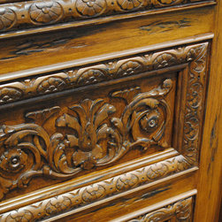 Carved and Mansion Entry Doors - Close up image of a Tuscan style hand carved door in Mahogany. Door was stained and distressed.