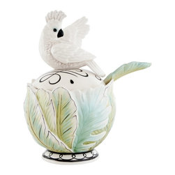 Fitz and Floyd - Fitz and Floyd 29-503 Cockatoo Jar with Spoon - 29-503 - Shop for Bowls and Candy Dishes from Hayneedle.com! The only way to make the Fitz and Floyd 29-503 Cockatoo Jar with Spoon sweeter is by filling it with sugar. This durable jar is crafted of earthenware in a pale white green and blue palette. A lovely accessory to add a little tropical beauty to your dinner or tea it's a perfect addition to the rest of the Cockatoo set (sold separately).About Fitz and FloydFitz and Floyd is recognized worldwide as a leader amongst the style- and quality-conscious. For 50 years their unique designs have made them the leader in the purveyor of hand-painted ceramic dinnerware tableware accessories giftware and collectibles. All Fitz and Floyd pieces are easy to spot. Each piece is distinctively hand-crafted by artisans from the drawing board to the sculpting wheel and kiln.The company's Dallas-based studios are renowned for producing over 500 unique designs per year. Creations range from presidential dinnerware for the White House or a tea service for Her Majesty Queen Elizabeth II to the perfect centerpiece for your table and each design is lovingly crafted in the highest quality. Meticulous craftsmanship and exquisite detail make every Fitz and Floyd piece a treasured heirloom-quality gift.