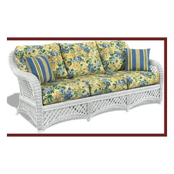 White Wicker Sofa: Lanai Style - White wicker is a classic.  It never goes out of style...never.  This beautiful sofa would be delightful on a screened in porch or in a sunroom.  Choose from a wonderful array of lovely fabrics and have it covered to suit your taste.
