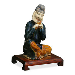 China Furniture and Arts - Tang Tri-Color Statue - Exemplifying Tang period aesthetic tastes such as rich coloration, relaxed facial expression, loose flowing garments, and elaborate hairstyle, the figure depicted here is of Middle Eastern origin. Middle Eastern people were seen frequently travelling along the silk road through China during the Tang dynasty (618-907), and this statue reflects the Chinese fascination and amusement by Central Asian culture.
