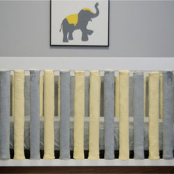 Go Mama Go Designs - Go Mama Go Designs Wonder Bumpers Grey & Yellow 24 Pack Multicolor - 89200000212 - Shop for Crib Bumper Pads from Hayneedle.com! About Go Mama Go Designs Wonder Bumpers Grey & Yellow 24 PackScientifically proven to be safe Wonder Bumpers offer padded protection on the crib's hard rails without the risk of suffocation or entanglement. Compared to standard bumpers which have proven to be a suffocation risk Wonder Bumpers offer increased airflow and reduce CO2 re-breathing. The protect baby's head and body and inhibit toddlers from climbing out of their cribs. They also keep limps safely inside. Wonder Bumpers have a sleek vertical design that effortlessly zips onto your crib rails in a downward motion ensuring babies don't have access to the pull. With no ties to worry about they're easy to use and easy to wash.