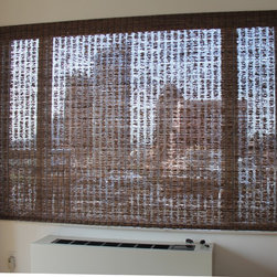 Lisa in Downtown Brooklyn Has Natural Wovens - Lisa was looking to add a little privacy to her bedroom and reduce the heat but she didn't want to give up her view. She ultimately choose a natural woven waterfall shade in Fiji/Chestnut with loop control.