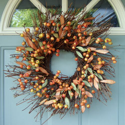 Fall Berry Wreath by Country Prim - This twig-style wreath is almost too pretty to put outdoors. I love using a smaller wreath with an antique hurricane adorning the center as a grand centerpiece.