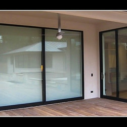 Multi Slide - Bifold Doors - Photo Credit: XO Windows - Multi Slide - Bifold Doors