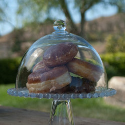 Dome Pedestal Cake Stand - Give your sweets the proper home with this Cake Dome. Donuts, cupcakes, and cookies rest easy here until they are ready for you to serve! If you're in need of a dessert to display, we suggest our gourmet fudge brownies, yum! Measures 10.25 inches in diameter.