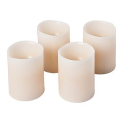 Wax Melted-Edge Flameless LED Battery-Operated Pillar Candles, Set of 4 - Flickering candles instantly relax me, but I don't want guests to have to monitor candle flames. These LED ones provide all the comfort without any risk of flames getting out of control.