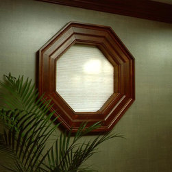 Octagonal interior window with a shade - Comfortex makes specialty shape shades to match our Symphony honeycomb shades.  Photo by Comfortex