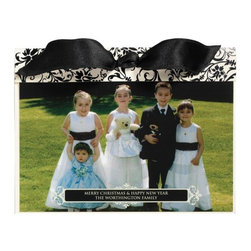 """Exposures - Printed Photo Black Tie Card Set of 20 - Overview The elegance and sophistication of a black tie event are incorporated into this unique printed photo card. Your photo and personalized signature are printed directly onto card stock, which is layered into an ivory card featuring chic black foil details. A stylish black satin ribbon ties the card together and provides the finishing touch to your special holiday card. Easy assembly. With all your card personalization included, sending customized holiday greetings is easier than ever!  Features:  Upload, edit and preview your photos and personalization in our online design tool Signature smooth card stock Set of 20 photo cards Includes 20 coordinating gold foil-lined ivory envelopes Includes foil envelope seals to add a special finishing touch Includes 20 black, pre-cut satin ribbons for tying Foil details on outer card  Personalization  All card personalization is included, up to 2 lines of personalized text, 35 characters per line.  Envelope personalization available in black and is imprinted on the back flap of the envelope. Up to 3 lines, 45 characters per line No returns on personalized items unless the item is damaged or defective   Specifications  Specifications:  Order online only Requires 1 photo This design works with either a vertical format (portrait) photo or a horizontal format (landscape) photo Assembled card size 8"""" x 6"""" Easy assembly. Line up ribbon holes of insert and outer card, fold flap over insert, tie ribbon   Shipping  Please allow an additional 2-3 weeks delivery No returns on personalized items unless the item is damaged or defective We cannot deliver to a PO Box delivery address for this item"""