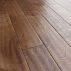 White Oak Hardwood Flooring - White Oak flooring is full of light tones that give a crisp, clean feel. It has long been a versatile standard in homes across the U.S. because of its universally complementary combination of deep grayish-brown heartwood and pale white tones. It also carries with it the feeling of tradition. White Oak hardwood flooring is also known for its durability, strength, and resistance to wear, serving as planking for boats and even mine timbers. The amazing decorative flexibility of White Oak hardwood makes it an outstanding floor for all settings and occasions. Our White Oak comes in a variety of colors and stains to suit any decor. Additionally, our FSC certified engineered White Oak floors feature enhanced dimensional stability over standard solid white oak floors.