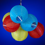 Pacific Coast - Solar Powered Paper Globe Lantern LED String Light Set - Create a romantic setting and a soft, colorful glow with these Solar colored lantern string party lights. Perfect for entertaining or adding ambiance anytime, anywhere, each of the colored Febric lantern party lights on this 10-piece strand is made of polyresin. It provides 6-8 hours of illumination, depending on sunlight conditions, and has an on/off turn switch on the solar panel. Safe to string indoors or outside, this set includes a solar panel with stake. Comes with one rechargeable Ni-MH AA battery.