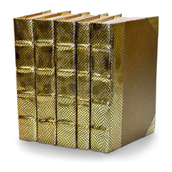 Exotic Metallic Collection - Gold  - Set of 5 - You can, indeed, judge a book by its cover. A visually striking set of decorative tomes, the Exotic Metallic Collection - Gold - Set of 5  makes an impressive graphic statement when placed upon a shelf in an eclectic great room, a window ledge in a home office, a fireplace mantel embellished with objets d'art, or glass-fronted armoire in a personal library.