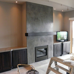"""Monolith Fireplace - GFRC fireplace surround. Hand finished and sealed. Over-all size 64"""" wide x 10' tall. Two panels, 5/8"""" thick. Custom countertops 24"""" x 58"""" on both sides."""