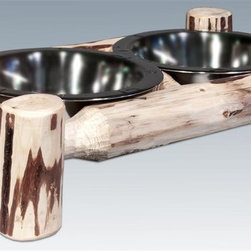 Montana Woodworks - Small Pet Feeder - Includes two 1 quart embossed stainless steel bowls. Hand crafted. Skip peeled by hand using old fashioned draw knives. Heirloom quality. Solid lodge pole pine. Mortise and tenon joinery system. Made from U.S. solid grown wood. Lacquered finish. Made in U.S.A.. No assembly required. 17 in. W x 9 in. D x 4 in. H (3 lbs.). Warranty. Use and Care InstructionsEach piece signed by the artisan who makes it.