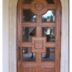 Custom Arched Solid Distressed Wood Entry Door 8' Height - Custom arched solid distressed wood entry door with clear glass and specially designed top, middle and bottom panels for a front entry with flat black door pull, deadbolt and hinges.