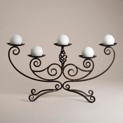 Scroll Centerpiece Candleholder - I have a lot of clients that prefer more traditional decorating, and I think this would be a perfect option for them. Candles are always a safe bet, and I really like how this candelabra sits high but is see-though enough that your guests can still see each other.