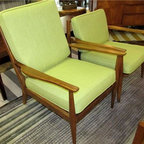 Pair Danish Modern Lounge Chairs- Austin - This awesome pair of 1960s spindle-back chairs has been completely restored! Each has new straps, refinished wood and new lime green cushions. These mid century chairs have been a staple for years and continue to be popular because they are easy to use anywhere. To view more items like these go to Red Chair Market.