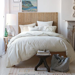 Overlapping Woven Headboard - Sleep in a natural setting. Woven banana bark forms a textured grid, bringing a natural, slightly tropical look to the bedroom.
