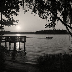 The Andy Moine Company LLC - Fishing Boat at Sunset Lake Talquin Florida Fine Art Black and White Photography - Black and White Fine Art Photography captured with 35MM Ilford Film and reproduced in Limited Editions on Canvas OR Brushed Aluminum. This is a beautiful composition of a lone fishing boat seen silhouetted by the setting sun and Spanish moss at Lake Talquin just outside Tallahassee Florida.