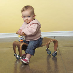 Kids - Bent laminated walnut scooter with 3-form discs. Photo by Greg Christman