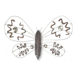 The Moth Sculpture - We created this lovely moth from reclaimed metal. The metal we used is from weathered steel. We hand draw the pattern on the metal with soapstone and cut it with a hand held plasma cutter. We then hand hammer and weld it into shape.