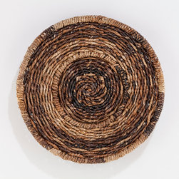 Round Madras Chargers - These woven chargers would add a rustic look to a table.