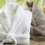 Cozy Robe, Large, White - Made from soft, thick poly microfiber, our deeply plush robe warms and relaxes with true spa style. 100% brushed microfiber polyester in a knitted weave. 300-gram weight. Cut with a full shawl collar, roll-up long sleeves, two patch pockets and a self belt. Hangs from a loop at the collar. Monogramming is available at an additional charge. Monogram will be placed on the upper left-side of the robe. Made in Turkey.