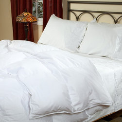 Belle Epoque - Belle Epoque Versailles Down Comforter - Year Round Multicolor - 79512 - Shop for Duvets from Hayneedle.com! The classic Belle Epoque Versailles Down Comforter - Year Round is ideal for any bed in the house. This all-purpose blanket is the perfect weight for any season and hot or cold sleepers alike. You won't have to worry about changing your bedding with the seasons since this blanket uses the temperature-modulating properties of down to capture the right amount of body heat to ensure comfort in any situation.With a cover made from silky luxurious 400 thread count 100% cotton this comforter is stuffed with white goose down and feathers with a deluxe fill power of over 750. The baffled box-stitch construction uses an inner wall of fabric to let the fill loft to achieve its maximum capacity while the quilted pattern keeps the stuffing evenly distributed throughout the comforter. This comforter is conveniently machine-washable and is backed by a five-year limited warranty.Comforter Dimensions:Twin: 71 x 88 inchesFull/Queen: 92 x 95 inchesKing: 110 x 95 inchesAbout CGG Home FashionsWhether you are shopping at Bloomingdale's or relaxing at a premier resort you are sure to find and appreciate CGG Home Fashions products. For over 20 years the company has been offering a broad selection of luxury linens high thread count sheets duvet covers pillows down and synthetic comforters drapes and table linens. CGG's acclaimed Belle Epoque collection is the epitome of elegance with styles ranging from traditional to contemporary. With offices and a warehouse in Yonkers New York and a showroom on New York's Fifth Avenue CGG is at the epicenter of textile design and innovation.